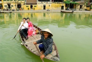 Couple sightseeing on boat along Hoai river